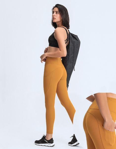 wholesale quick dry spandex women fitness leggings with phone pocket manufacturers
